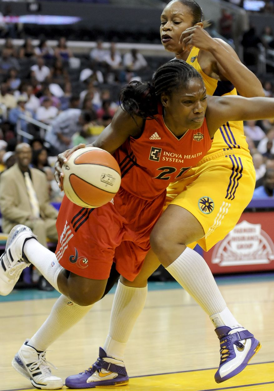 Washington Mystics forward Nicky Anosike (shown against the Los Angeles Sparks) only scored five points, but also grabbed a season-high 14 rebounds in the Mystics' 86-79 loss to the Atlanta Dream on Tuesday. (AP Photo/Gus Ruelas)