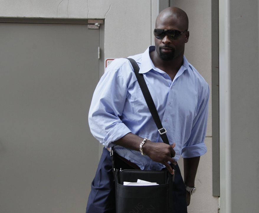 Vonnie Holliday with the Washington Redskins leaves the NFL Players Association on Wednesday, as talks to end the NFL lockout continued. (AP Photo/Carolyn Kaster)