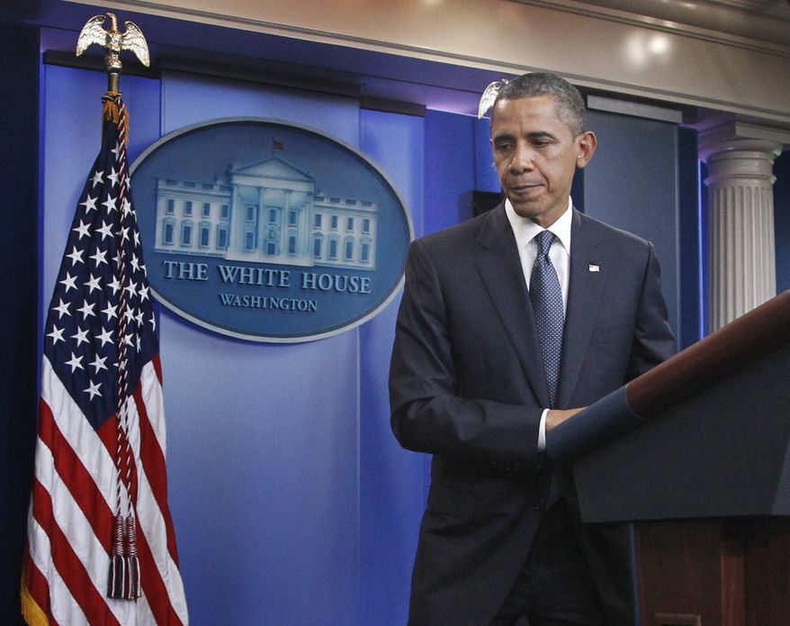 President Obama leaves the White House briefing room after discussing the continuing budget talks on Tuesday, July 19, 2011, in Washington. (AP Photo/Manuel Balce Ceneta)