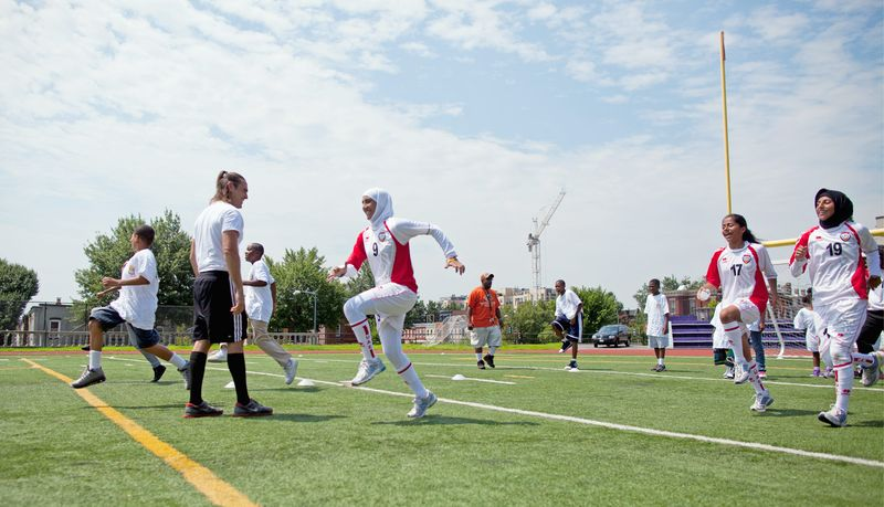 """The United Arab Emirates women's soccer team does drills with children from the Boys & Girls Club of Greater Washington. """"These girls are pioneers,"""" said Connie Selby, the United Arab Emirates women's coach. (Pratik Shah/The Washington Times)"""