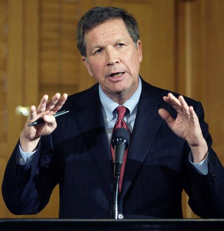 Ohio Gov. John Kasich signed Senate Bill 5 into law March 31 limiting collective-bargaining rights of public employees. Mr. Kasich, a Republican, said he will play a visible role in defending the law in the lead up to a November repeal vote. (Associated Press)