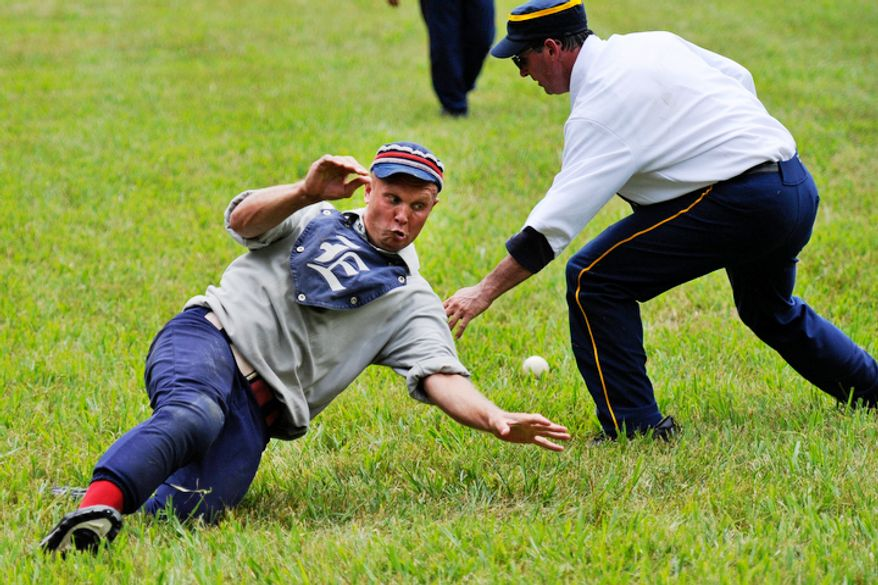 "Elkton Eclipse centerfielder Erik ""Dubs"" Meyers, of Chesapeake, Md.,  slides into home plate as he avoids a tag from Potomac Nine catcher Jeff ""Piper"" Hornberger, of Crofton, Md., during the Loudoun Preservation Society's 19th Century Baseball Day. (Drew Angerer/The Washington Times)"