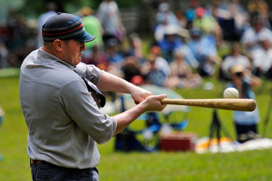 "Elkton Eclipse outfielder Glyn ""Hammer"" Richards, left, of Mt. Ephraim, N.J., hits a pitch during a game during the Loudoun Preservation Society's 19th Century Baseball Day. (Drew Angerer/The Washington Times)"