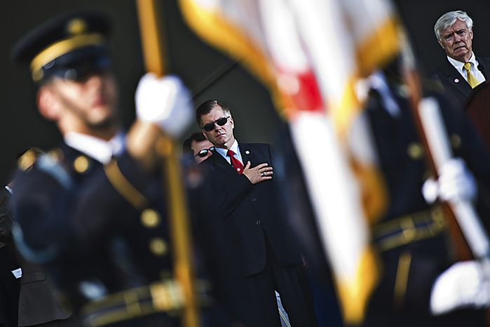 Virginia governor Bob McDonnell is seen while the colors are presented during at the opening ceremony of the commemoration of the 150th anniversary of the First Battle of Manassas/Bull Run, in Manassas, Va., Thursday, July 21, 2011. At right is Virginia Speaker of the House William J. Howell. (Drew Angerer/The Washington Times)