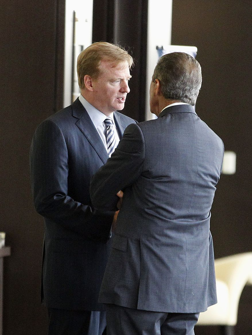 NFL commissioner Roger Goodell speaks with Atlanta Falcons owner Arthur Blank during an NFL owners labor committee meeting in College Park, Ga., on Thursday. (AP Photo/John Bazemore)