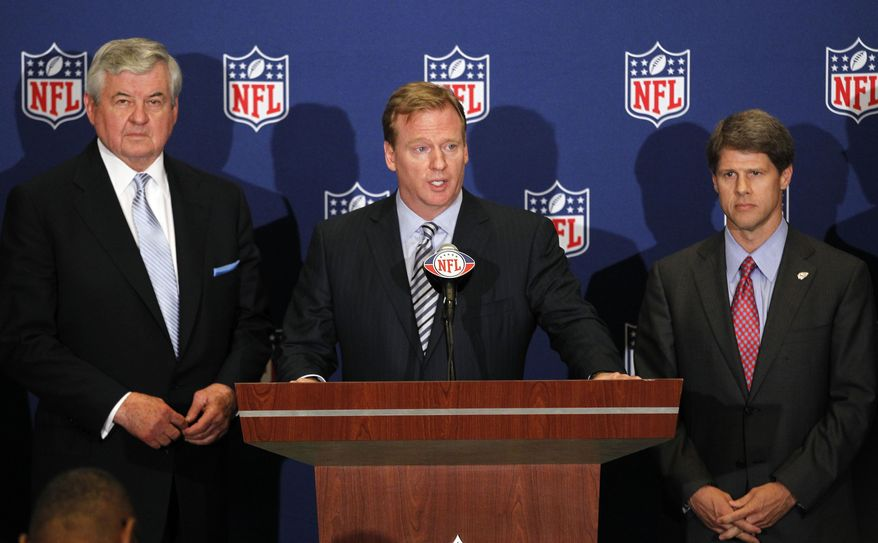 NFL football commissioner Roger Goodell announces that NFL owners have agreed to a tentative agreement that would end the lockout pending the players approval in College Park, Ga., on Thursday, July 21, 2011. Carolina Panthers owner Jerry Richardson, left, and Kansas City Chiefs owner Clark Hunt look on. Players have balked at the proposal. (AP Photo/John Bazemore)