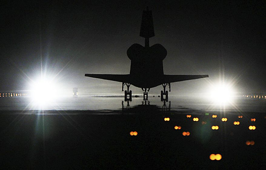 Space shuttle Atlantis lands at the Kennedy Space Center at Cape Canaveral, Fla., on Thursday, July 21, 2011. The landing of shuttle marks the end of NASA's 30-year space shuttle program. (AP Photo/James Nielsen, Houston Chronicle )