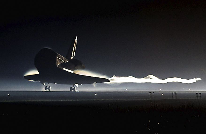 Space shuttle Atlantis lands at the Kennedy Space Center at Cape Canaveral, Fla., on Thursday, July 21, 2011. The landing of the spacecraft marks the end of NASA's 30-year shuttle program. (AP Photo/Pierre Du Charme, Pool)