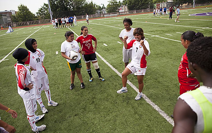 Jalila Al Nuimi, 7, of the UAE women's national soccer team gets her team pumped up during a soccer clinic at Cardozo High School in Northwest Washington, D.C. on Wednesday, July 13, 2011. (Pratik Shah/The Washington Times)