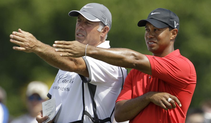 Tiger Woods announced on his website Wednesday that he and Steve Williams, who have been together since March 1999, will no longer be working together. (AP Photo/Lynne Sladky, File)