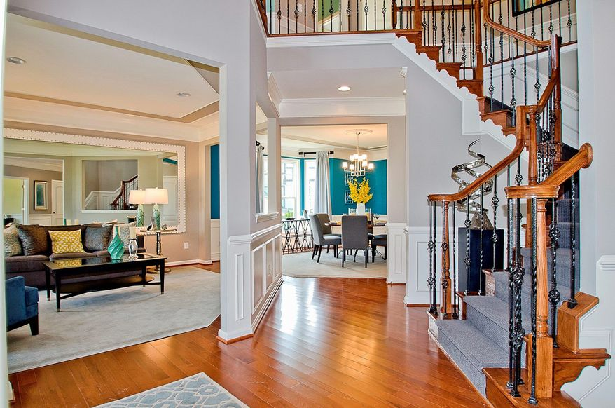The Avery model features a two-story foyer with a split staircase, which is accessed from the foyer and the family room.
