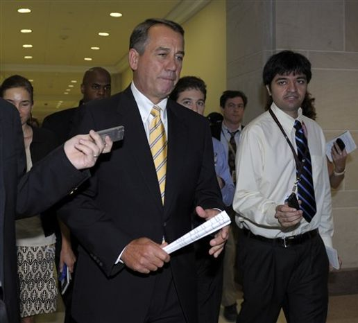 House Speaker John Boehner of Ohio is followed by reporters after a news conference on Capitol Hill in Washington, Thursday, July 21, 2011. (AP Photo/Susan Walsh)