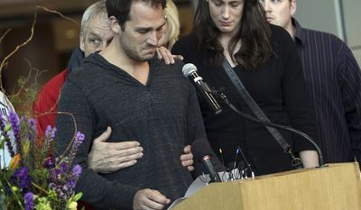 FILE - In this May 15, 2011 photo, Aaron Boogaard, left, breaks down while speaking about his brother Derek Boogaard during a public memorial service at the Xcel Energy Center in St. Paul, Minn., for Derek, who was found dead in his Minneapolis apartment a few days earlier. Aaron Boogaard has been arrested on suspicion of possessing illegal prescription pills on the night his brother died. Online records showed Aaron Boogaard was arrested Wednesday, July 20, 2011, on a narcotics charge. He was held without bail in the Hennepin County Jail in Minneapolis. (AP Photo/Star Tribune, Renee Jones Schneider, File)