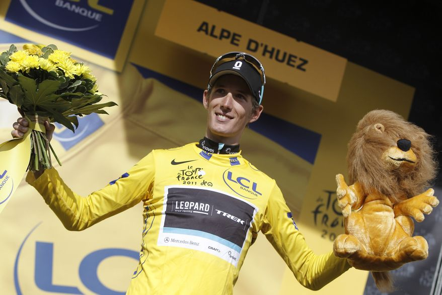 Andy Schleck of Luxembourg, wearing the overall leader's yellow jersey, celebrates on the podium of the 19th stage of the Tour de France cycling race Friday. All that's left of the Tour de France is a weekend time trial and the final dash to the Champs Elysees in Paris. (AP Photo/Laurent Cipriani)