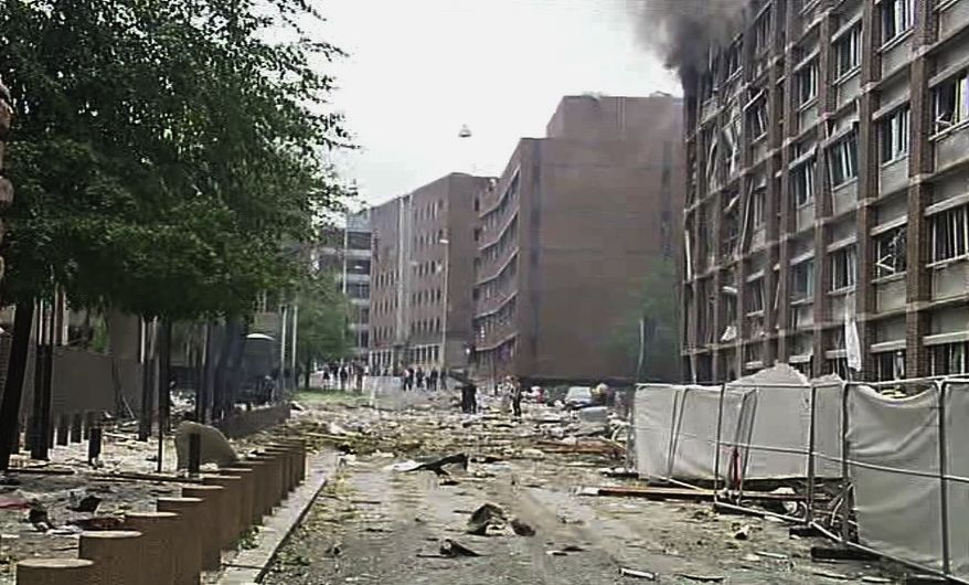 In this video image taken from television, smoke is seen billowing from a damaged building as debris is strewn across the street after an explosion in Oslo, Norway, Friday, July 22, 2011. A loud explosion shattered windows Friday at the government headquarters in Oslo, which includes the prime minister's office, injuring several people. Prime Minister Jens Stoltenberg is safe, government spokeswoman Camilla Ryste told The Associated Press. (AP Photo/TV2 NORWAY via APTN)