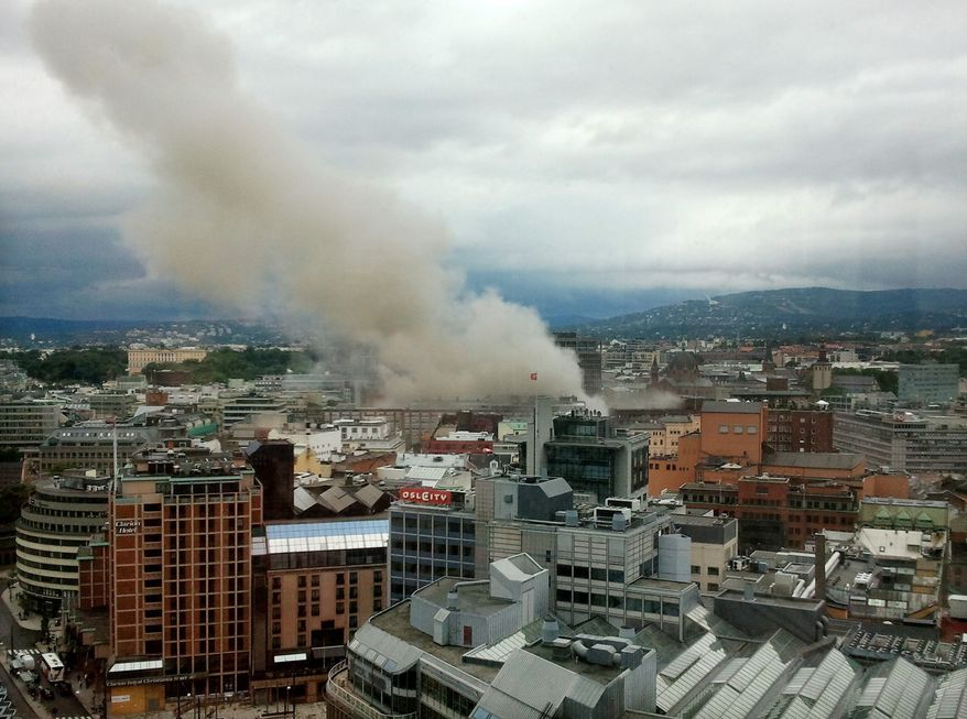Smoke rises from the central area of Oslo Friday, July 22, 2011 after an explosion. Terrorism ravaged long-peaceful Norway on Friday when a bomb ripped open buildings including the prime minister's office and a man dressed as a police officer opened fire at a nearby island youth camp. (AP Photo/Scanpix, Jon Bredo Overaas)