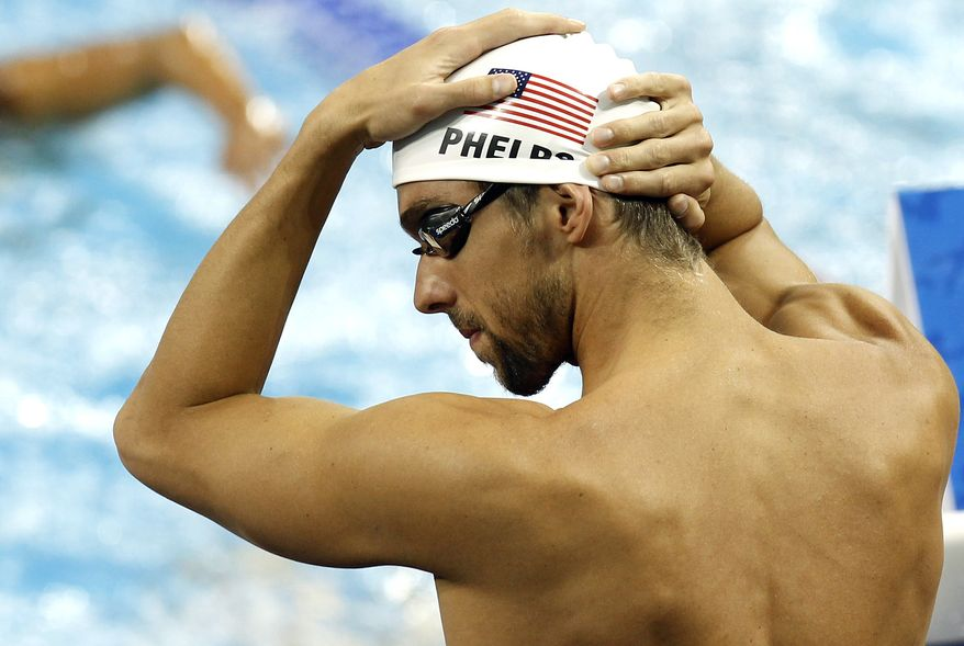 U.S. swimmer Michael Phelps adjusts his cap prior to a training session at the FINA 2011 Swimming World Championships in Shanghai, China on Thursday. (AP Photo/Wong Maye-E)