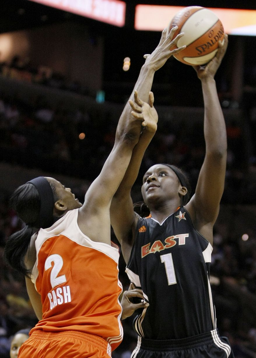 East's Crystal Langhorne, right, shoots over West's Swin Cash during the first half of the WNBA All-Star basketball game, Saturday. East won 118-113. (AP Photo/Darren Abate)