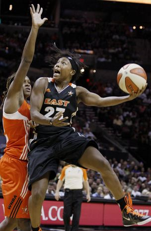 East's Cappie Pondexter shoots over West's Rebekkah Brunson during the first half of the WNBA All-Star game Saturday. East won 118-113. (AP Photo/Darren Abate)