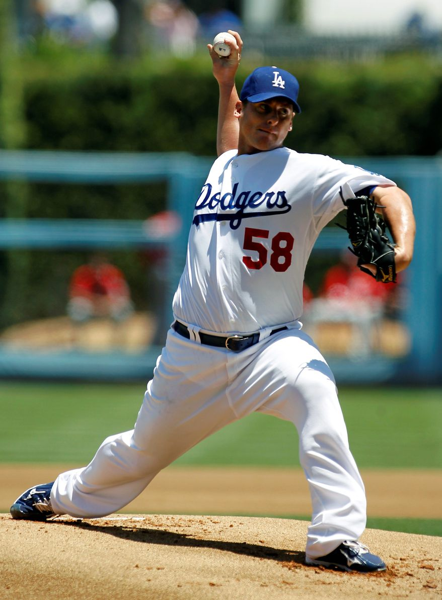 Los Angeles Dodgers starting pitcher Chad Billingsley delivers against the Washington Nationals during the first inning of a baseball game, Sunday, July 24, 2011, in Los Angeles. (AP Photo/Danny Moloshok)