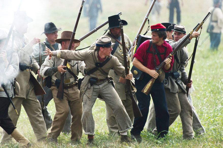 Confederate soldiers make their move to Union troops during the 150th Anniversary of the Battle of First Manassas/Bull Run Reenactment, at Pageland Farm, in Gainesville, Va., Sunday, July 24, 2011. (Drew Angerer/The Washington Times)