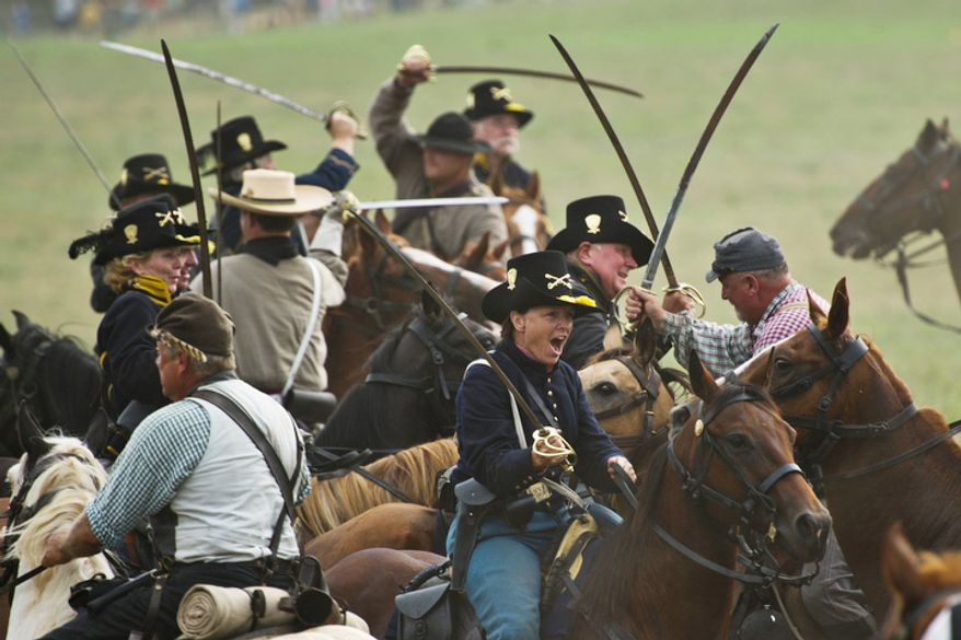 Union and Confederate calvary units engage in combat. (Drew Angerer/The Washington Times)
