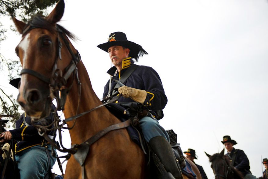 Union calvary units march toward the battlefield during the 150th Anniversary of the Battle of First Manassas/Bull Run Reenactment. (Drew Angerer/The Washington Times)