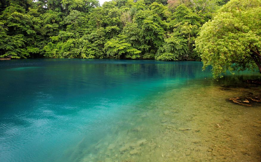 Conservationists say Blue Lagoon in Port Antonio, Jamaica, is increasingly under threat by developers and the government's lackluster efforts at enforcing environmental laws. (Associated Press)