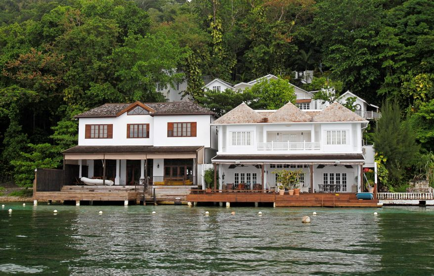 Luxury villas line the shore near Blue Lagoon, where bird-watchers and nature lovers flock off the beaten track. The Jamaica National Heritage Trust has completed research to make the lagoon a protected national monument. (Associated Press)
