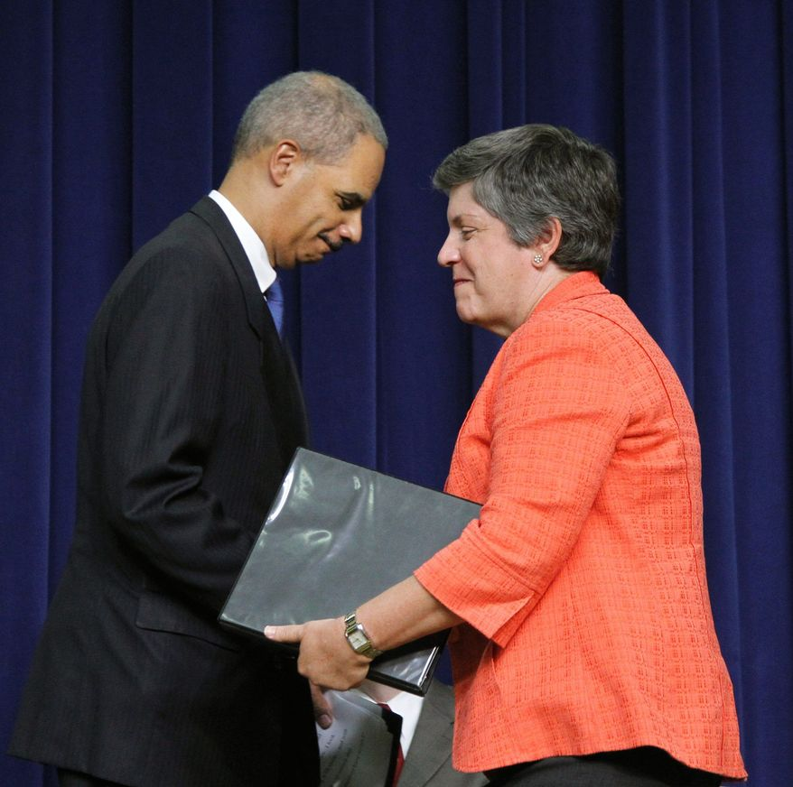 Attorney General Eric H. Holder Jr. greets Homeland Security Secretary Janet Napolitano on Monday during for the announcement of the Strategy to Combat Transnational Organized Crime. (Associated Press)