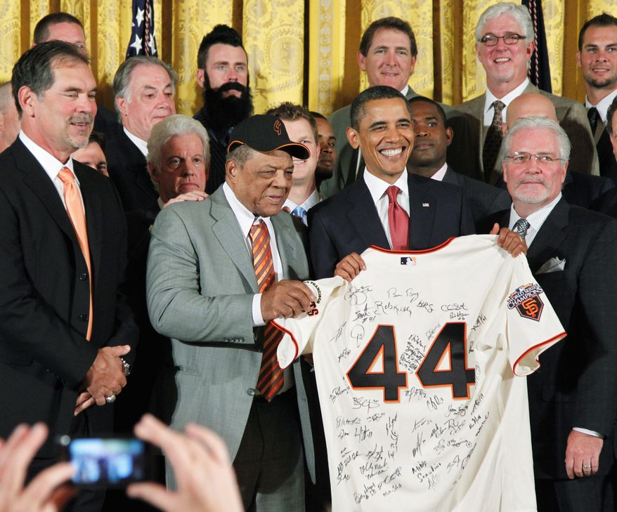 President Obama and baseball legend Willie Mays hold an autographed San Francisco Giants jersey at the White House on Monday. Giants manager Bruce Bochy (left) presented Mr. Obama with the jersey while his team was honored for its 2010 World Series championship. (Associated Press)