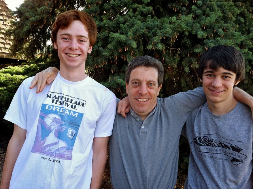 This photo provided by the Gottsegen family shows Sam Gottsegen (left), Jon Gottsegen (center) and Ben Gottsegen in the backyard of their Denver home in late June 2011. Sam, 17, was one of four teens attacked by a mother grizzly bear near Talkeetna, Alaska, on July 23, 2011. (Associated Press)