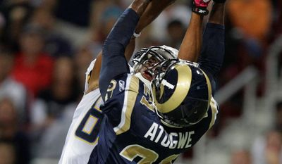 St. Louis Rams safety Oshiomogho Atogwe (21) intercepts the ball over San Diego Chargers wide receiver Malcom Floyd (80) for a touchback during the first quarter of an NFL football game Sunday, Oct. 17, 2010, in St. Louis. (AP Photo/Jeff Roberson)