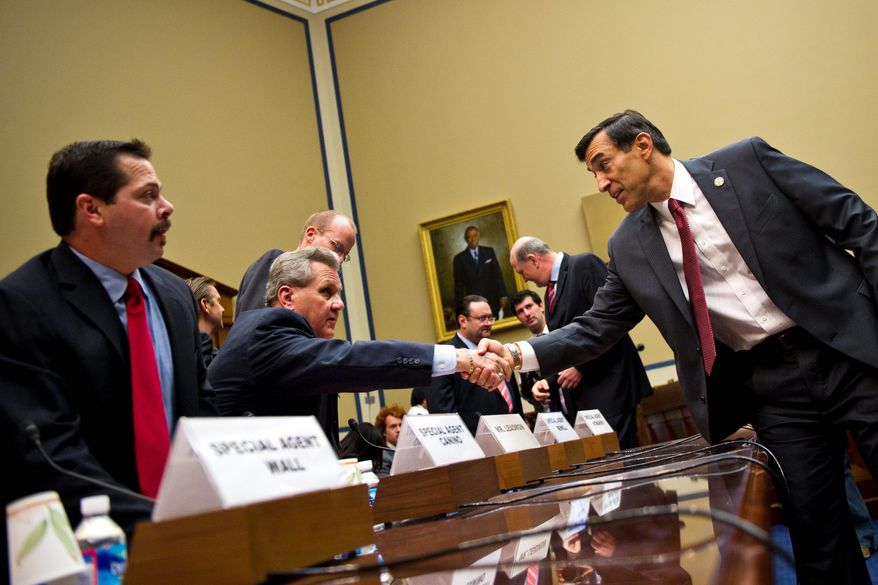 "House Oversight and Government Reform Committee Chairman Rep. Darrell E. Issa, California Republican (right), greets Lorren Leadmon, an ATF intelligence operations specialist, before the hearing Tuesday about the fallout from ""Operation Fast and Furious."" At left is Carlos Canino, ATF acting attache to Mexico."