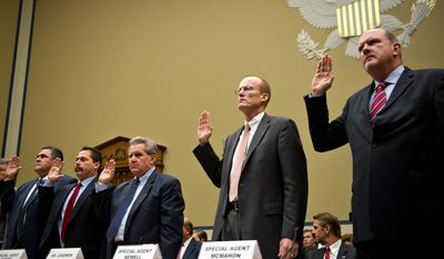 """PHOTOGRAPHS BY DREW ANGERER/THE WASHINGTON TIMES ATF officials are sworn in Tuesday at a House Oversight and Government Reform Committee hearing on the failings of """"Operation Fast and Furious."""" From left are: Jose Wall, senior special agent; Carlos Canino, acting attache to Mexico: Lorren Leadmon, intelligence operations specialist; William Newell, former special agent in charge; and William McMahon, deputy assistant director for field operations."""