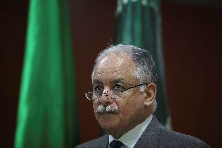 ** FILE ** Former Libyan Prime Minister Al-Baghdadi Al-Mahmoudi (Associated Press)