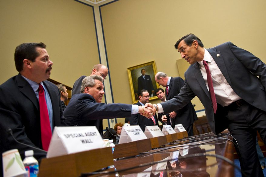 Committee Chairman Rep. Darrell Issa, R-Calif., shakes hands with Lorren Leadmon, ATF Intelligence Operations Specialist, prior to a House Oversight and Government Reform hearing looking into the Justice Department's firearms trafficking investigation, Operation Fast and Furious, on Capitol Hill Washington, D.C., Tuesday, July 26, 2011. At right is Carlos Canino, ATF Acting Attaché to Mexico. (Drew Angerer/The Washington Times)