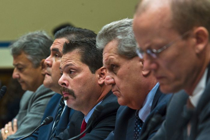 From left, Jose Wall, ATF Senior Special Agent, Carlos Canino, ATF Acting Attaché to Mexico, Lorren Leadmon, ATF Intelligence Operations Specialist, William Newell, Former ATF Special Agent in Charge listen  during a House Oversight and Government Reform hearing looking into the Justice Department's firearms trafficking investigation, Operation Fast and Furious, on Capitol Hill Washington, D.C., Tuesday, July 26, 2011. (Drew Angerer/The Washington Times)