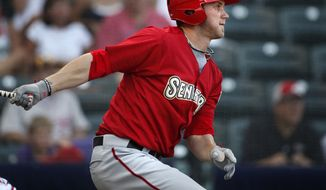 ** FILE ** Harrisburg Senators' Bryce Harper follows through on a grounder back to the pitcher during the second inning of a baseball game against the Richmond Flying Squirrels in Richmond, Va., on Thursday, July 21, 2011. (AP Photo/The Richmond Times-Dispatch, Dean Hoffmeyer)