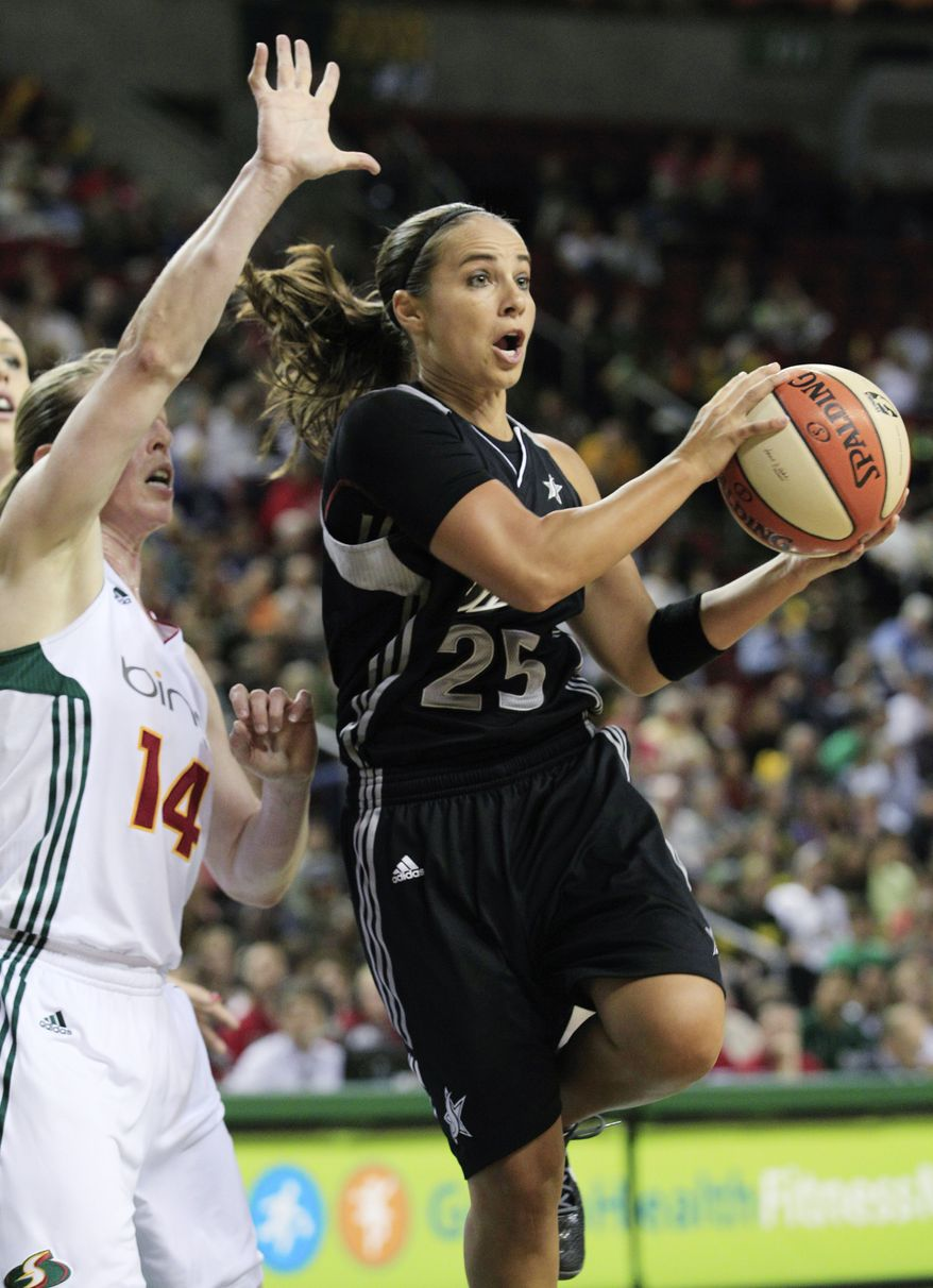 San Antonio Silver Stars' Becky Hammon scored a game-high 22 points in the Washington Mystics' 73-67 loss Tuesday night. (AP Photo/Elaine Thompson)