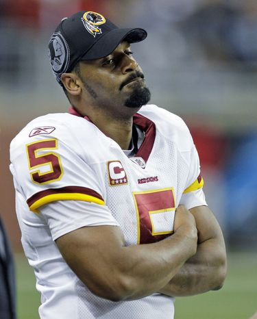 Quarterback Donovan McNabb isn't in the Redskins' plans, but he still was on the team as of Wednesday evening. (Associated Press)