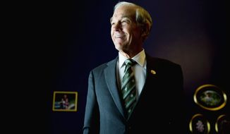 "HEARD: ""The magnificence of what is happening right now,"" Ron Paul says, ""is [people] are starting to pay attention."" (Drew Angerer/The Washington Times)"