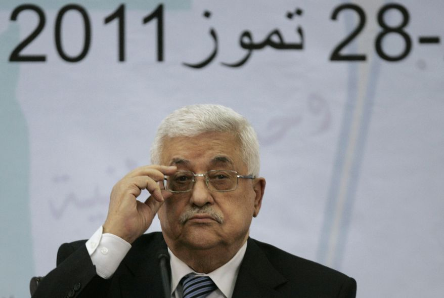 Palestinian President Mahmoud Abbas attends a meeting of the Central Committee of the Palestine Liberation Organization in the West Bank city of Ramallah on July 27, 2011. (Associated Press) ** FILE **