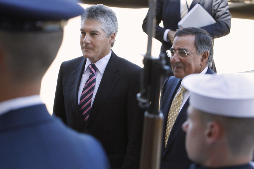 Defense Secretary Leon Panetta, right, escorts Australian Minister of Defense Stephen Smith into the Pentagon, Wednesday, July 27, 2011, during an honor cordon. (AP Photo/Jacquelyn Martin)