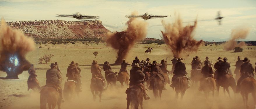 "ASSOCIATED PRESS PHOTOGRAPHS Townspeople in the Old West ride off to battle an enemy not from this world in ""Cowboys & Aliens."" The film stars Daniel Craig (below) and Harrison Ford."