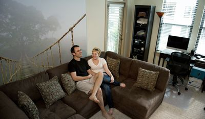 Jesse McLaughlin and Lisa Harbin relax in their Arlington apartment. They share housekeeping duties, and he says he actually enjoys doing dishes by hand. Ms. Harbin has had her share of bad roommate experiences but also had a roommate in college whose habits were very different from hers but became a close friend. Being a roommate can teach how to get along with others.