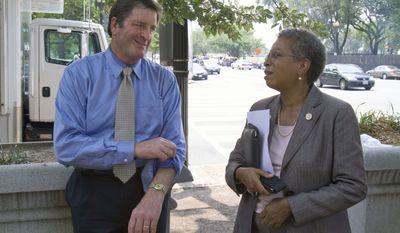 Rep. John Garamendi, California Democrat (left) talks with Del. Donna Christensen, Virgin Islands Democrat, on Capitol Hill, Thursday, July 28, 2011. (AP Photo File/Harry Hamburg)
