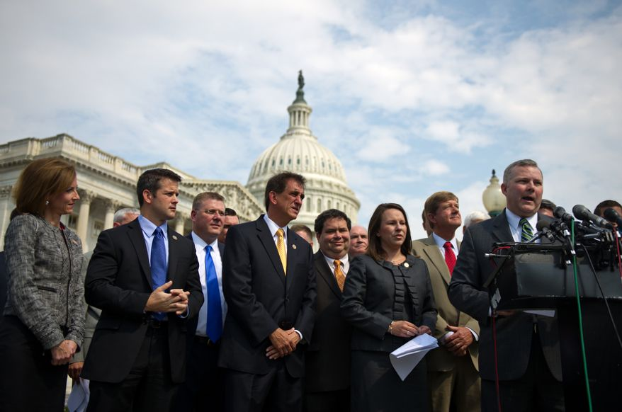 Led by Freshman Rep. Tim Griffin, R-Ark., speaking at right, Freshmen GOP lawmakers voice their support for the House debt bill, on Capitol Hill, in Washington, D.C., Thursday, July 28, 2011. (Drew Angerer/The Washington Times)