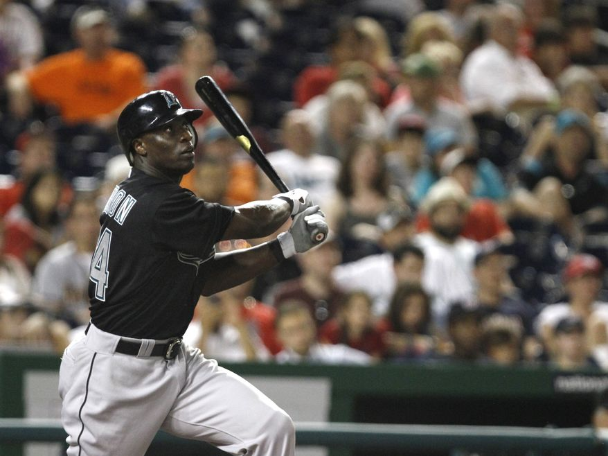 Outfielder Mike Cameron will retire after 17 seasons in the major leagues. He had signed a minor league deal with the Nationals this offseason. (AP Photo/Jacquelyn Martin)