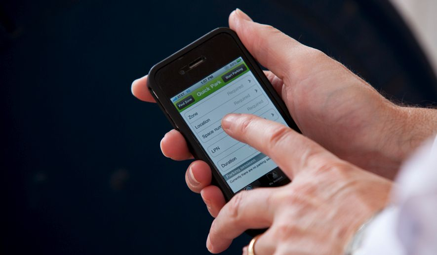 In this July 28, 2011, file photo, the ParkMobile app can be found on the iPhone. (Pratik Shah/The Washington Times) ** FILE **